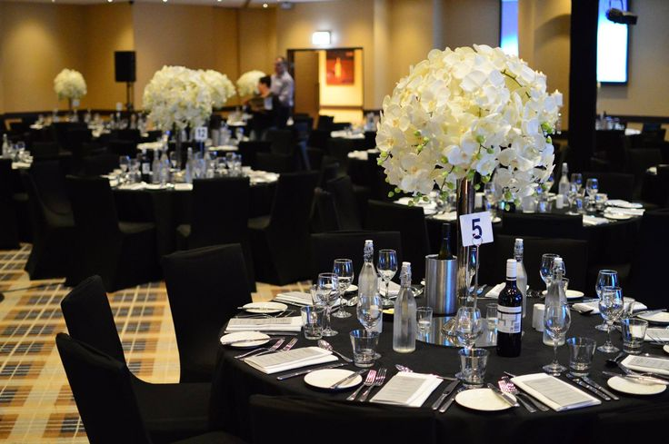 Beautiful floral centerpieces at an event at Rydges World Square Sydney.