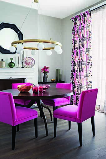 This dining room is brought to life with lipstick pink velvet chairs. Touches of gold add another layer creating a glamorous counterpoint to dark wood floors and furniture. Homes & Gardens, June 2014. Styling Claudia Bryant, photographs Jan Baldwin.