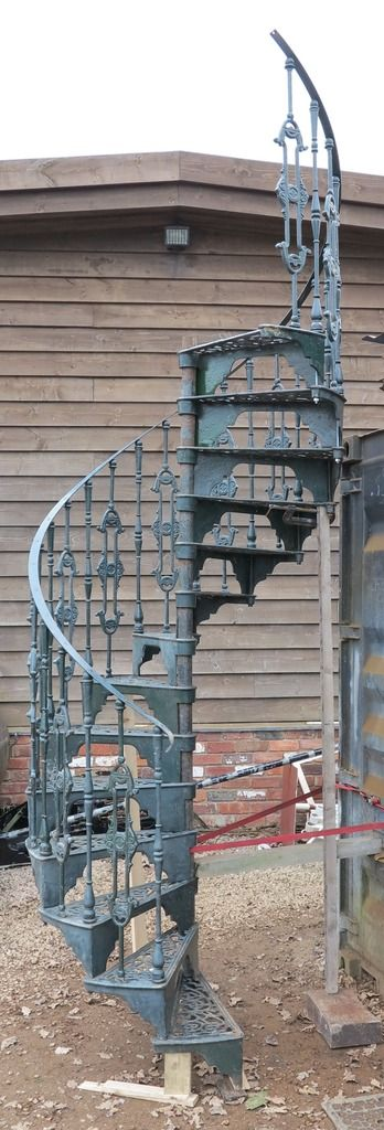 Cast Iron Spiral Staircase With Landing and Balcony Rails. This spiral staircase is available to purchase from UKAA.
