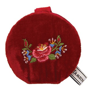 Intricate hand embroidered roses and rose buds adorn this mirror.
