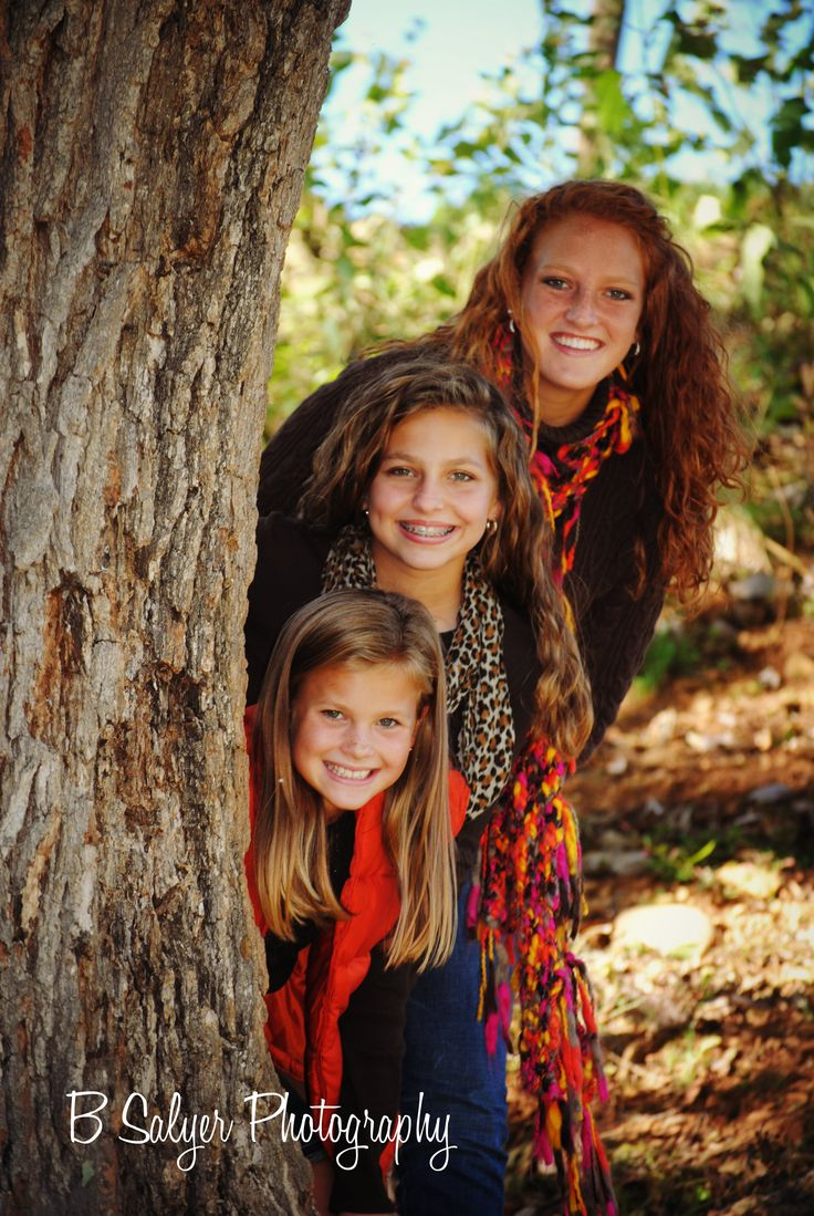 Have the girls play peek a boo from behind a tree....a must!