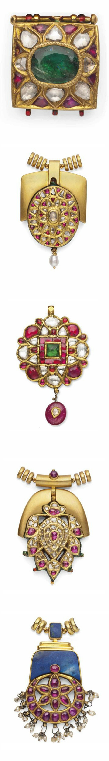 FIVE DIAMONDS AND GEM-SET PENDANTS INDIA, 19TH/EARLY 20TH CENTURY Four of circular form and one square, each with stylised floral decoration, inset with diamonds, foiled rubies and emeralds,the reverse decorated with enamelled floral sprays, each with modern laces and mounts