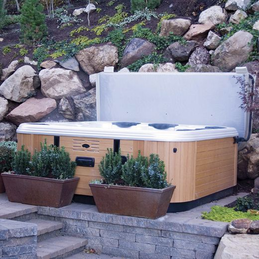 """Hot Tub Covers All our packages at Long Island Hot Tub come with a durable cover, which are very helpful for energy efficiency as well as safety. If you don't have one for some reason, we can assist you find one to match the shell of your hot tub, in such colors as: Cordovan, Tan, Portobello, Esperesso, White, Gray, Black, etc. — after all, we're talking about """"accessorizing.""""  http://www.longislandhottub.com/longisland_hot_tub_spa_blog/?p=2087"""