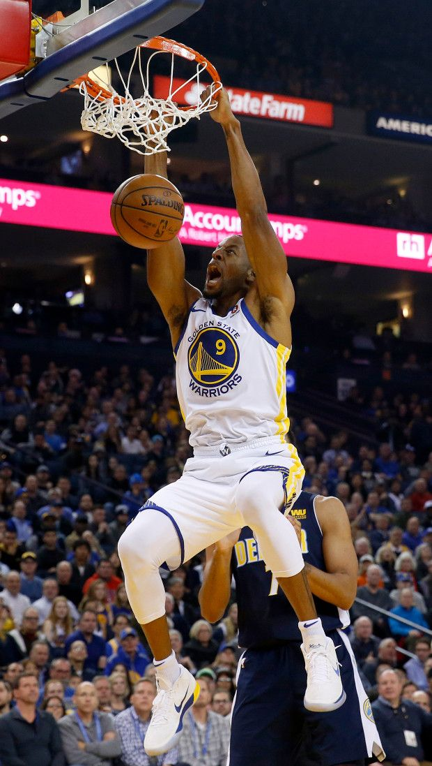 Golden State Warriors' Andre Iguodala (9) dunks past Denver Nuggets' Trey Lyles (7) in the first quarter of their NBA game at Oracle Arena in Oakland, Calif., on Monday, Jan. 8, 2017. (Jane Tyska/Bay Area News Group)