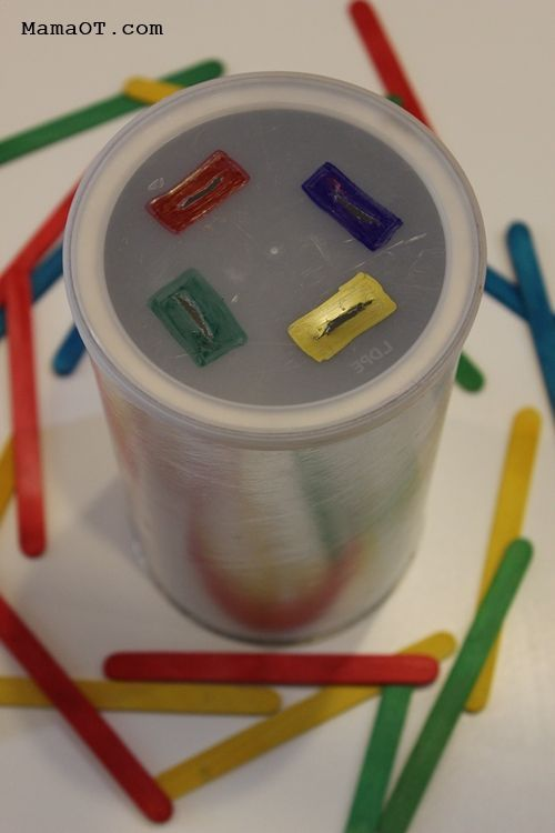 Simple preschool color matching activity that will also work on fine motor skills -- pushing colored popsicle sticks into an old coffee can!