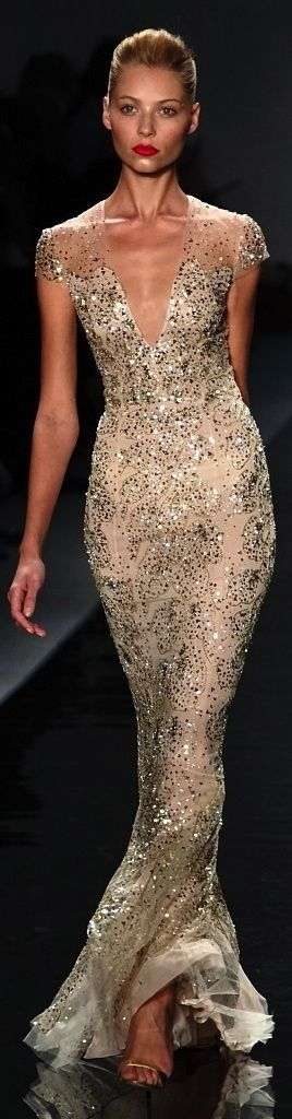 Reem Acra Love this! Wish it were kes low cut! But I love the sparkly and how form fitting and slimming it is!