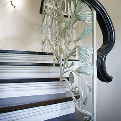 Luxurious interior wrought iron stair railing