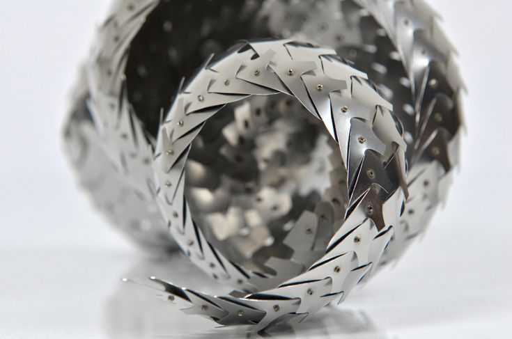 Nymphaea{close up) Stainless steel sculpture with rivets