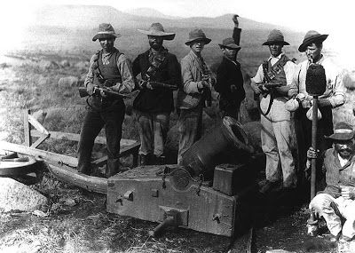 Boer's armed with German made 1896 Mauser rifles posing behind a small mortar #history