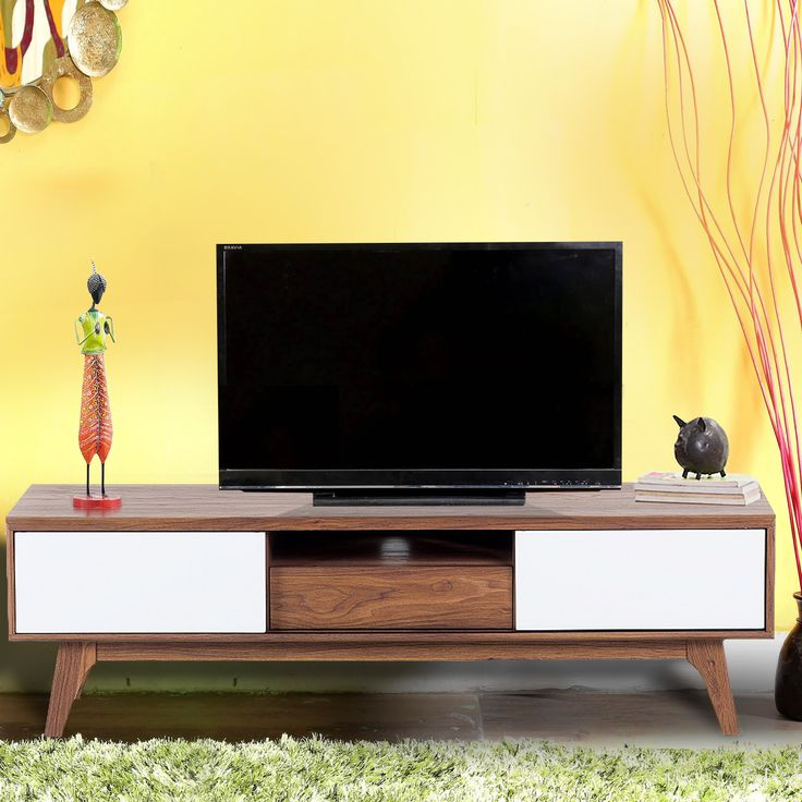 Give your living room a distinctive look with this eye-catching contemporary styled entertainment unit. It has a sleek design and fits most urban homes. It has one drawer and five shelves with sliding door that provide you with ample storage space for all your media essentials. Top this media unit with a sleek flat TV and enjoy watching a game or movies with family and friends. Its short angular wooden legs add to the TV unit's charm.