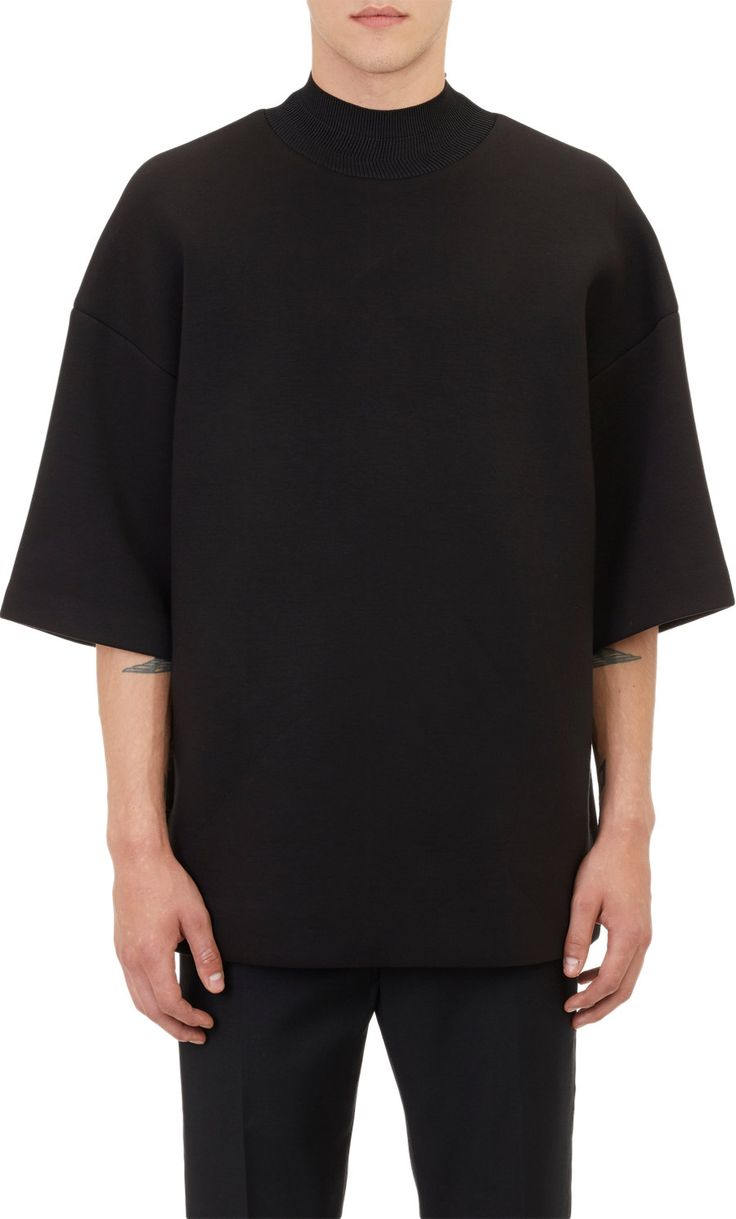 "Juun J Embroidered Neoprene Oversize T-shirt  Juun J black cotton-blend neoprene oversize T-shirt embroidered at back with ""LER-DILL.""  Rib-knit mock turtleneck, drop shoulders Lined Available in Black Rayon/nylon/cotton; lining: polyester Hand wash Made in Korea"