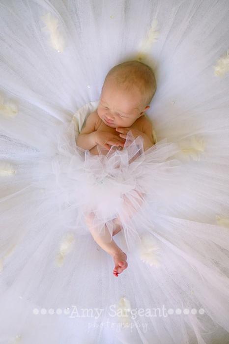 Ballerina baby, laying in her mommas tutu.