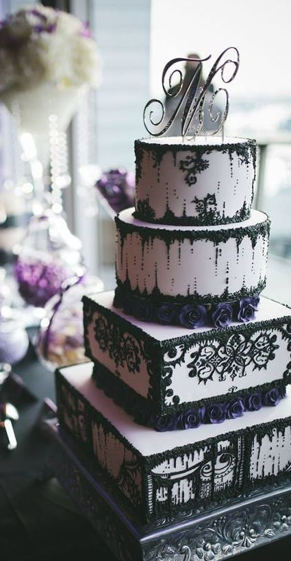 Sophisticated black and white wedding cake with purple flower detail; Featured Photographer: Amber Scobie Photography, Featured Cake: The Cake and I