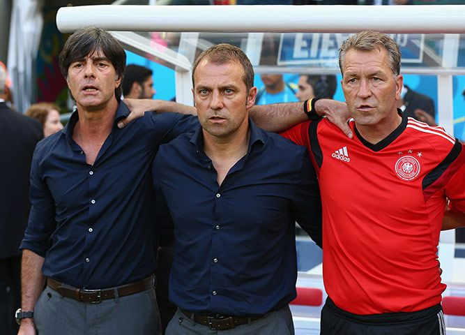 Credit: Martin Rose/Getty German coach Joachim Löw, assistant coach Hans-Dieter Flick and goalkeeper coach Andreas Köpke of Germany stand du...