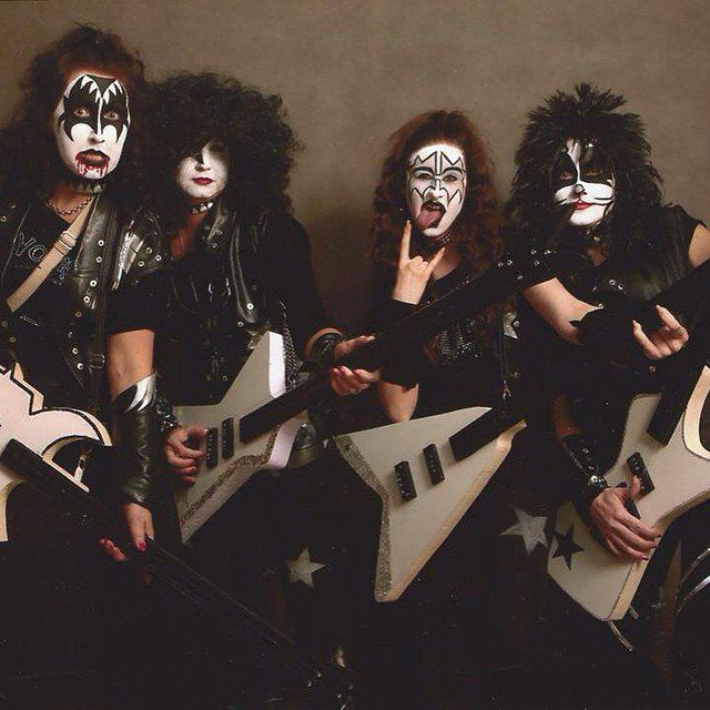 Pin for Later: 36 Real People Who Nailed Their Celebrity Halloween Costumes Kiss Face paint, big hair, guitars, and an overload of black leather are the essentials to nail this costume.
