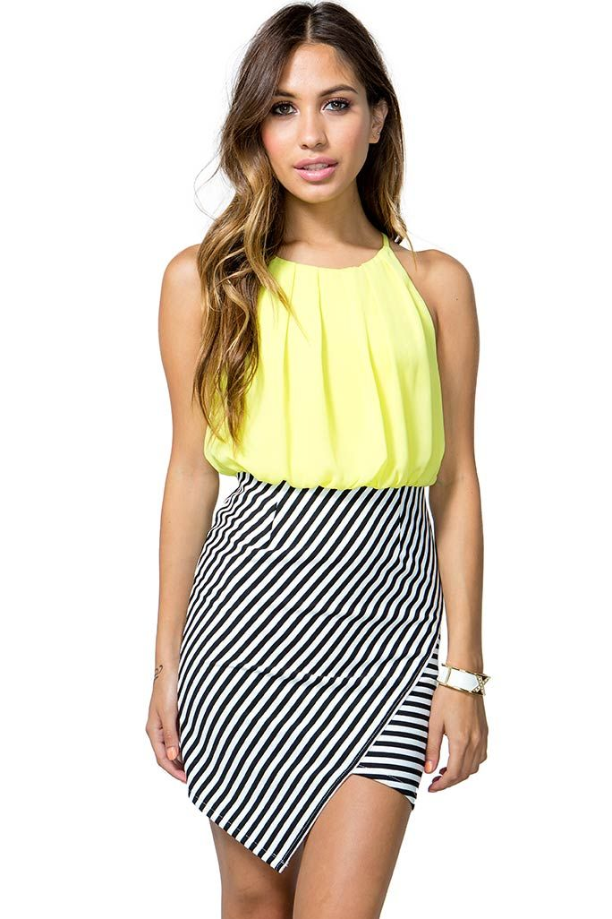 A bold 2-fer dress featuring a neon chiffon bodice and a striped ...