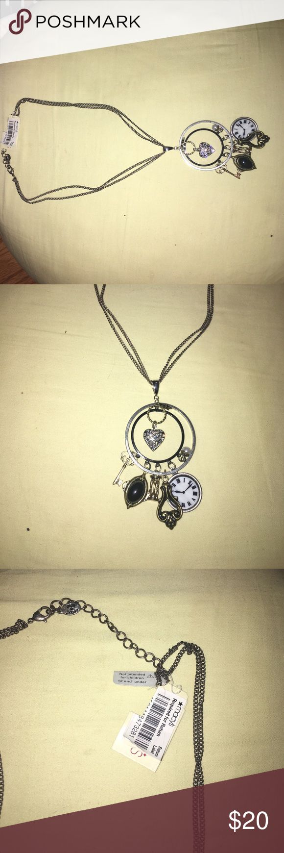 Alice in wonderland style necklace Brand new charm necklace designed in part by ideas of Alice and wonderland! Heart star key hour glass pearl and clock pendants! Comes with brand new bow tie ring! Macy's Jewelry Necklaces
