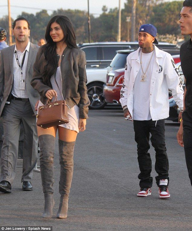 Hitting her stride! Kylie Jenner highlighted her long limbs with a pair of thigh-high taupe boots which clung to her legs