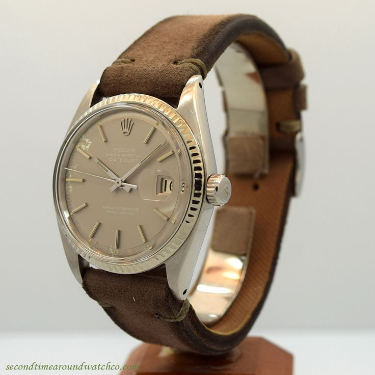 A 1957 Vintage Rolex Datejust Reference 1601 with a stainless steel case, a unique, patinated Grey dial with applied, steel baton markers, a 14K white gold fluted bezel and a 26-jewel caliber 1520 movement. This example also comes equipped with a 20mm, Sueded Genuine Leather Grey-colored watch strap. (Store Inventory # 10262, listed at $3250, available for purchase online and in store.)  #rolex #datejust #steel #calendar #vintage #watches #watch #classic #wristwatch #timepiece #wristwatches
