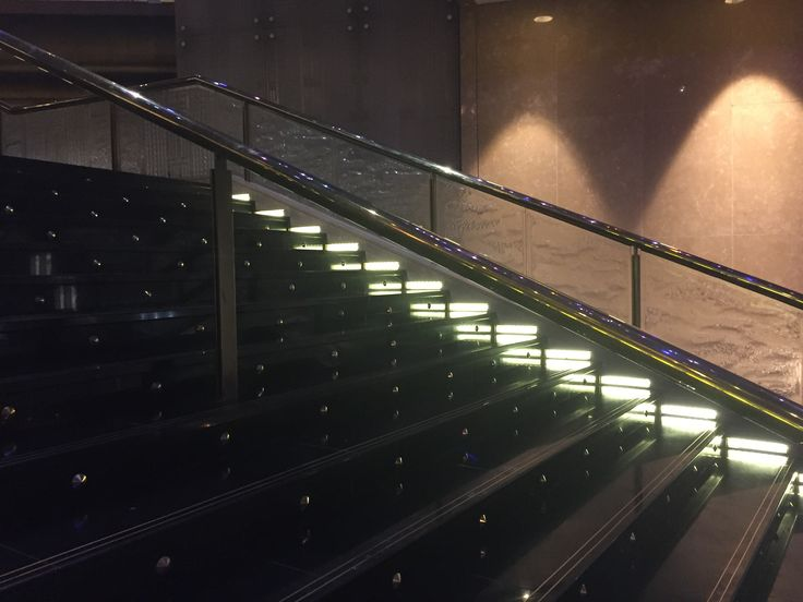 PHOTO EIGHT CROWN LOBBY: A over view of the stair case showing the materials, metal , glass marble. The use of lights on the stairs case helps to light the area and emphasize  the stairs. Walking into the large lobby you are attracted to the amazing and large staircase.