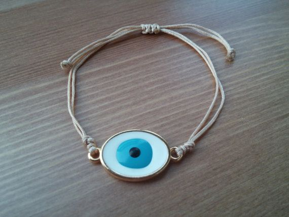 handmade bracelet with Gilded peephole and beige cord by toocharmy