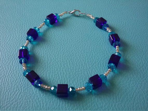 Hey, I found this really awesome Etsy listing at https://www.etsy.com/au/listing/264343175/blue-swarvoski-glass-bracelet