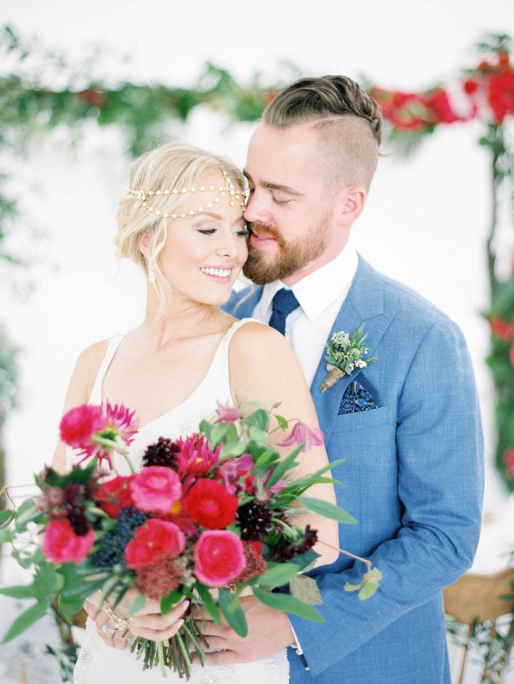 Destination wedding, bride and groom, Santorini, Bougainvillea bouquet, blue suit