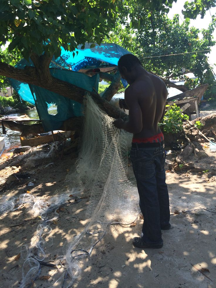 Fisherman mending his net, Negril Jamaica