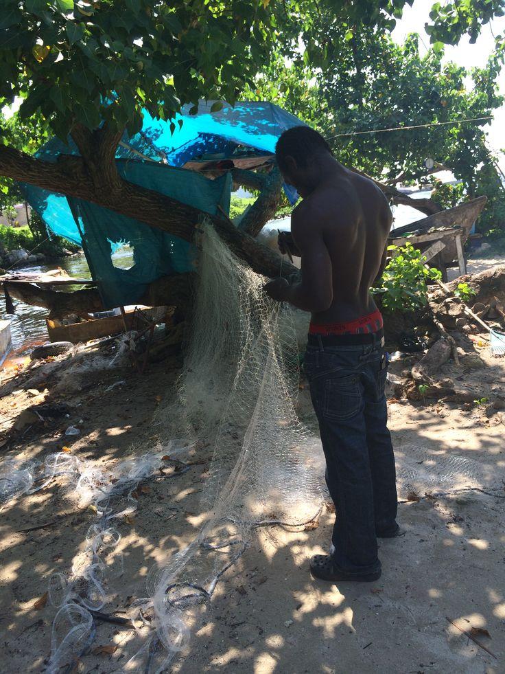 Fisherman mending his net, Negril Jamaica
