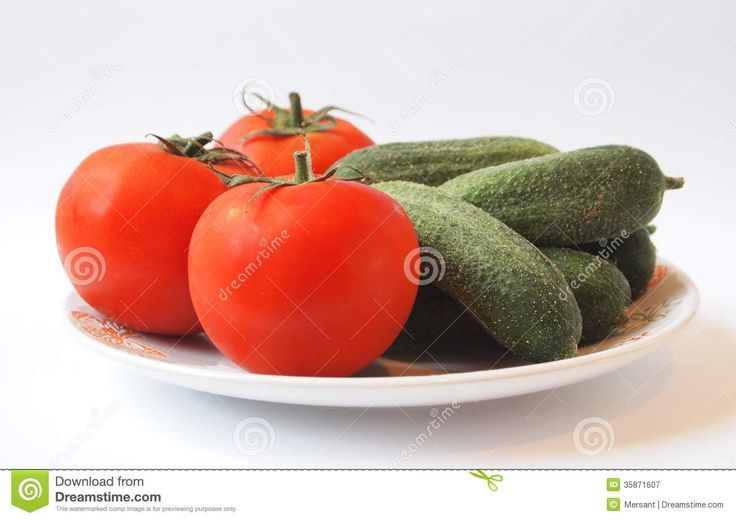 Some tomatoes and cucumbers on white background