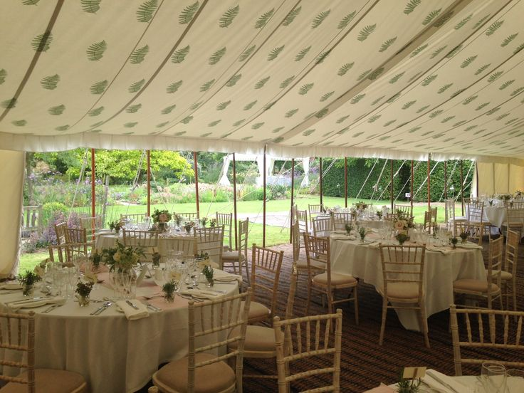 This is our beautiful Fern roof lining within our Traditional Canvas Pole Tent with open sides.