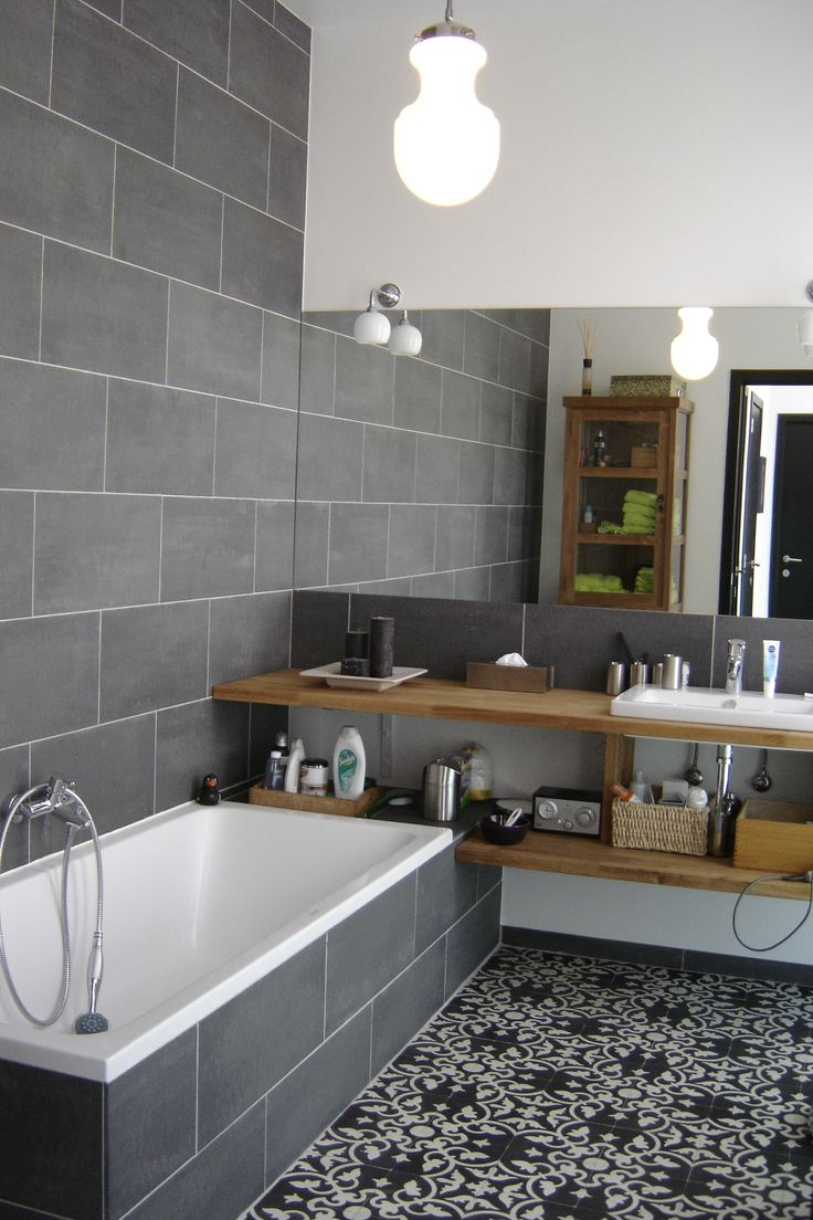 Bathroom with cement tiles. Great combination of classic, rustic and modern with Wooden accents