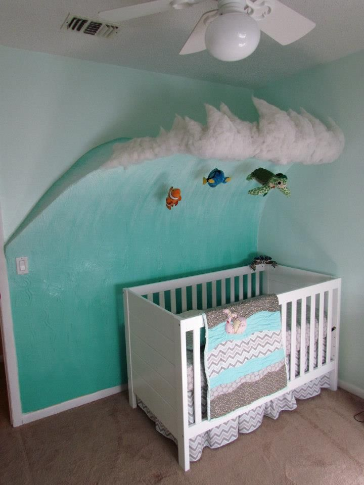 3-D wave for baby's nursery! Some thin plywood and spackle over it! top is cotton batting, and clear line to hang the fish :) instead of nemo fish hang foam surfboards cutouts painted the same color as cleats and starfish
