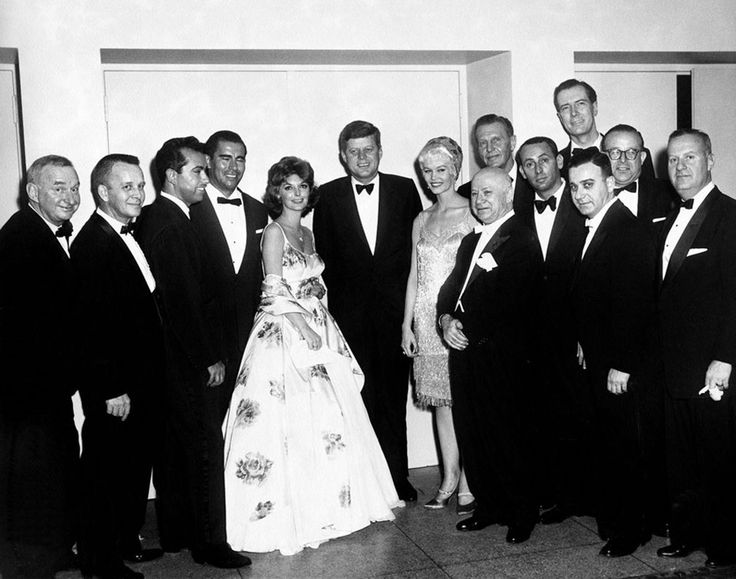 WHITE HOUSE CORRESPONDENTS' DINNER - 1961 - President John F. Kennedy with Julie London, Dorothy Provine, Ralph Bellamy, Joey Bishop & other officials. White House Correspondent's Dinner 1961