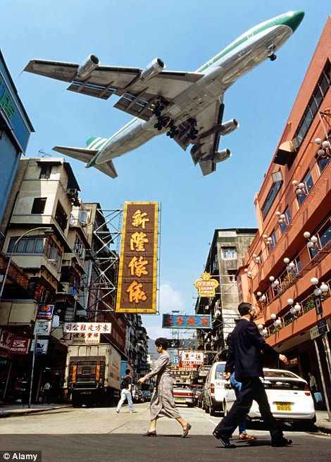 Kai Tak Airport, Hong Kong: With a perilous runway that jutted out into the sea, and an alarmingly steep descent through skyscrapers and mou...