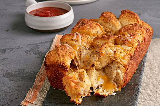 Get out the refrigerated biscuits and prepare to wow the crowd with this Tex Mex-style cheesy pull-apart bread.