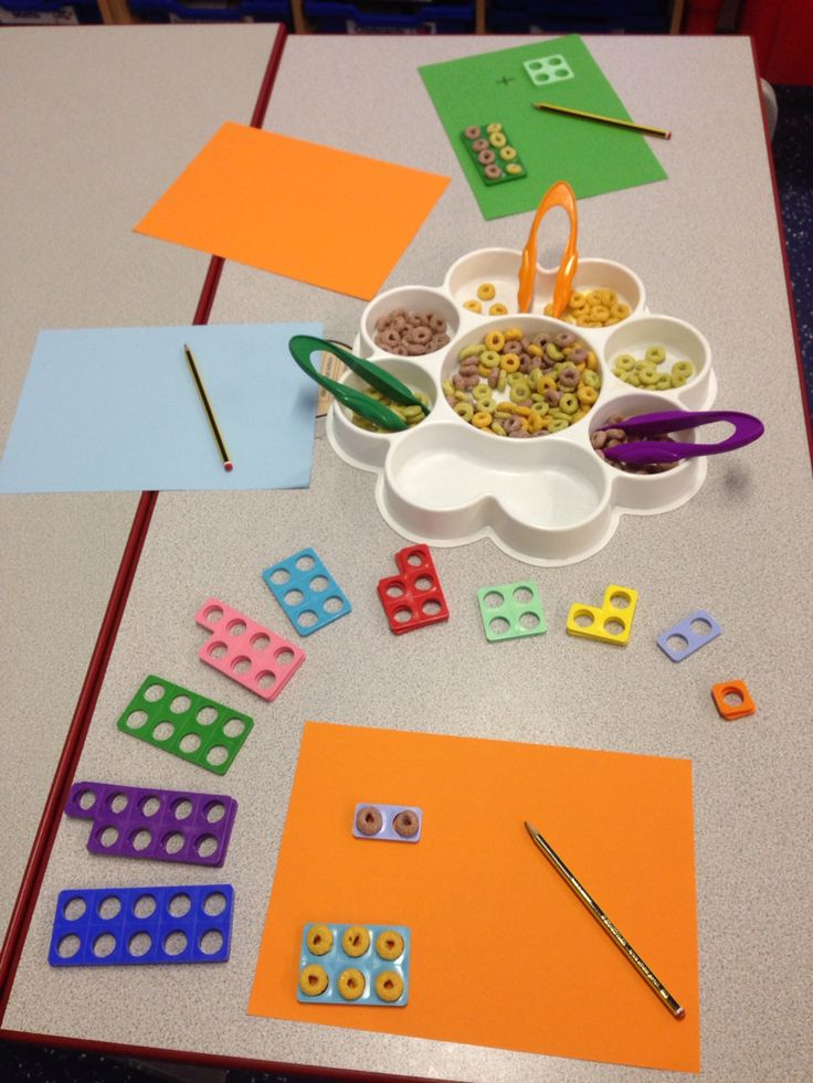 Using wheat hoops to fill in the Numicon spaces- helps support understanding of conservation of number.