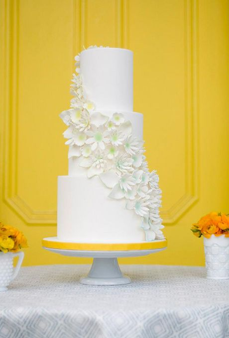 Brides.com: . The best cake designers find inspiration in the most creative and unusual places. Kelsey Robinson of The Whole Cake says the cascade of sugar flowers on this lemon-lavender-and-strawberry cake was inspired by a swim cap from the 1960s that was decorated with textured flowers. The centers of each gumpaste blossom were dry-brushed with edible paint for the slightest touch of color.   $17 per slice, The Whole Cake