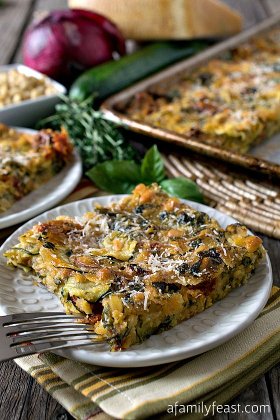 Scarpaccia - A Family Feast - Savory Zucchini and Onion Tart with spinach, sun dried tomatoes, basil, thyme and parmesan cheese