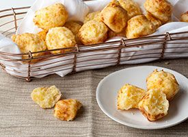 Brazilian Cheese Puffs (Pao de Queijo): Traditionally, these Brazilian-inspired cheese puffs would be piped out of a pastry bag and baked on a baking sheet, but putting the dough into mini-muffin tins makes them bake with perfect consistency. Either way, they're a favorite with kids.