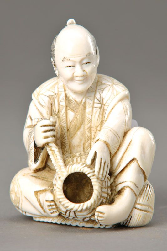 Ivory carving china in fisherman with fish trap