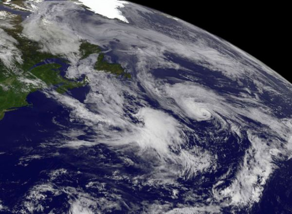 This June 21, 2012 handout image provided by NASA, shows a satellite view of Chris (Top Center of Image), the first hurricane of the season. Churning far out in the Atlantic, the Miami-based National Hurricane Center said the storm's top winds had jumped to 75 miles (120 kilometers) per hour as it moved to the northeast at 20 miles (32 kilometers) per hour.