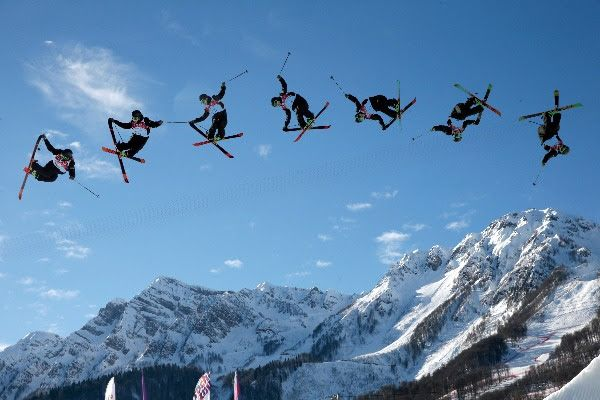 Image: In this image made with a multiple exposure, Finland's Antti Ollila competes in the men's ski slopestyle qualifying at the Rosa Khuto...
