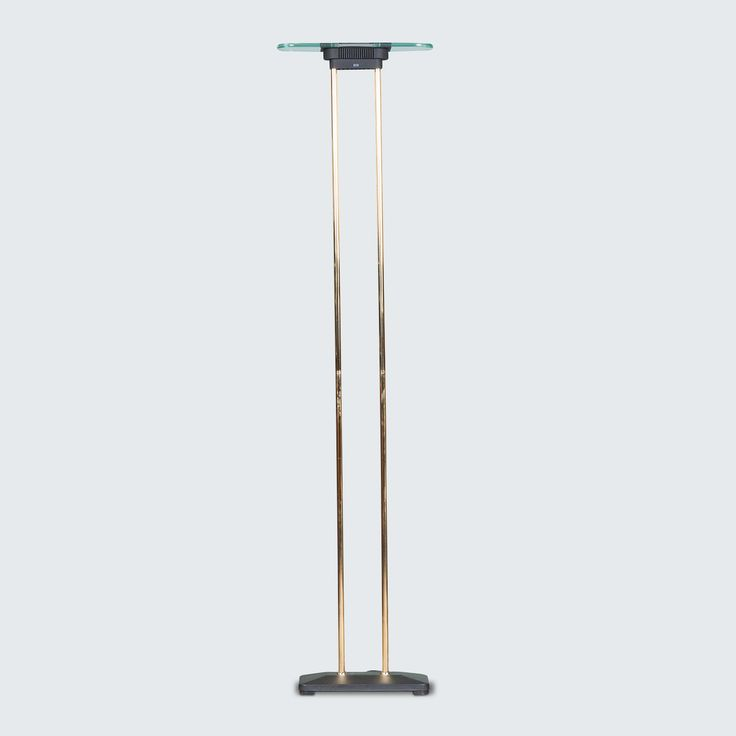 DUTCH FLOOR LAMP IN GLASS AND BRASS, 1960S line Absolutely amazing, this floor lamp is simple and stylish with two brass legs, sturdy black base and a two piece glass top joined by perforted black metal to project the light beautifully.