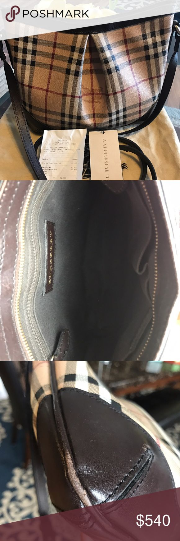 Burberry Haymarket check Excellent condition, gentle used Burberry cross body bag. Adjustable shoulder strap, Top Zip closure. Light scuff mark on the bottom on both side and on the top on both side. Made in Italy. Dust bag is include. Bought this bag in Keflavik airport in Iceland back in sept 2013. Have the original receipt of purchase. Burberry Bags Crossbody Bags