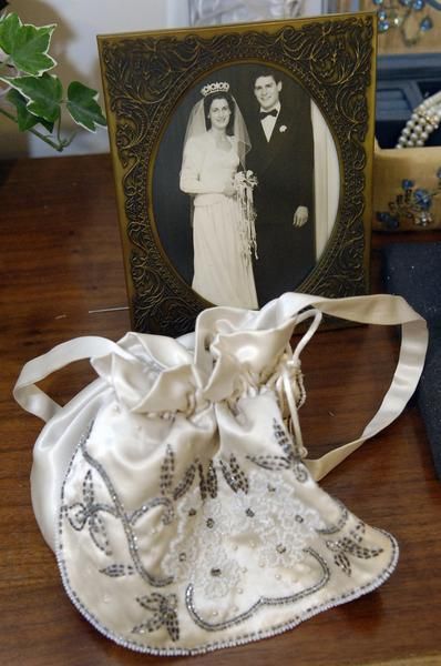 Recycling wedding gowns - Make a wedding purse for the bride.  With 3 girls this is such a great idea so they can all have a piece of my gown because let's face it, my dress will be outdated by the time they're getting married!!!