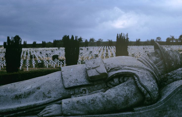 """WWI Alfred Eisenstaedt—The LIFE Picture Collection/Getty Images Caption from LIFE. """"At Douaumont a statue of a French soldier lies with 15,000 acctual dead."""""""