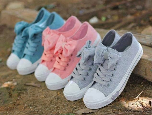ADORABLE! Converse with bows!!!! I deff need to get me a pair of these! <3