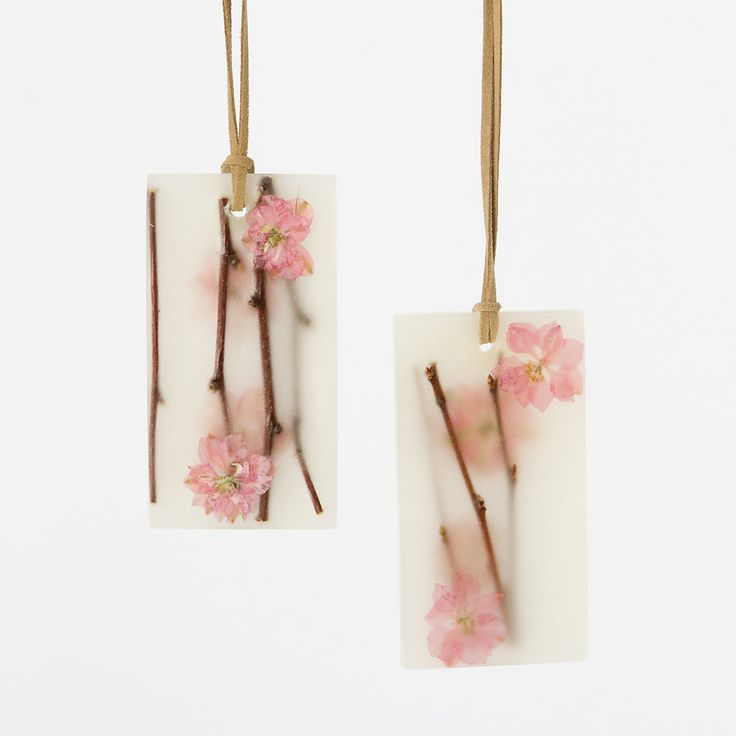 Pressed Flower Sachets, Cherry Blossom | Tuck these botanical wax sachets into a drawer, or hang in a closet with the attached suede cord, to spread the delicate scent of cherry blossom with notes of pear, freesia, and vanilla | Via Shop Terrain