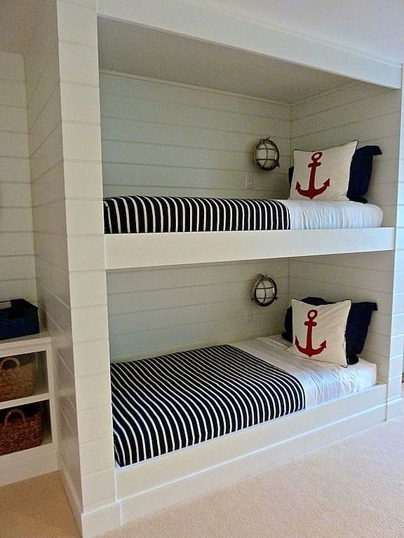 Vintage boat lights pull together this nautical bunk look and add just a hint of imagination. #twin #bed #stripes